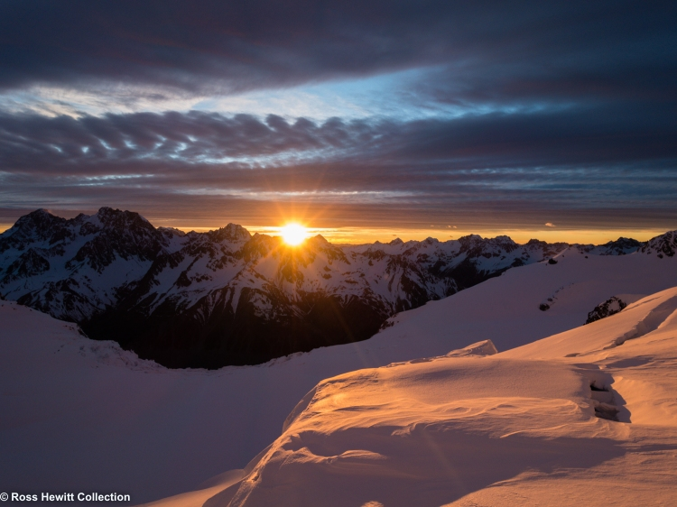 First Rays of sun from Aoraki Mount Cook NZ by Ross Hewitt