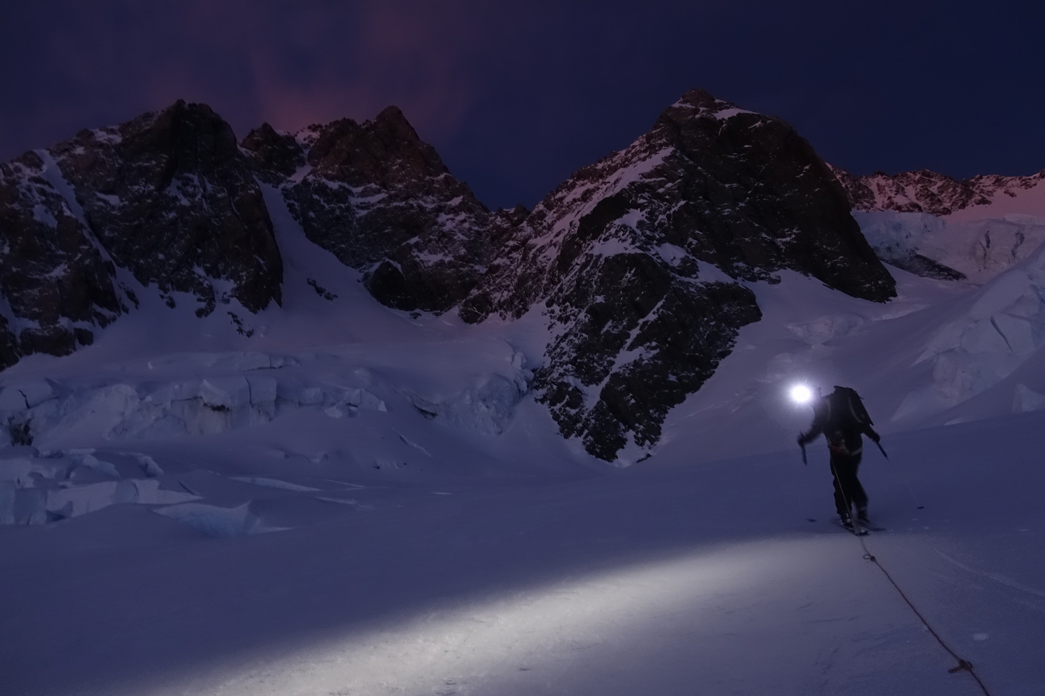 Ross Hewitt approaching the Bowie Couloir Aoraki / Mount Cook at night by Dave Searle